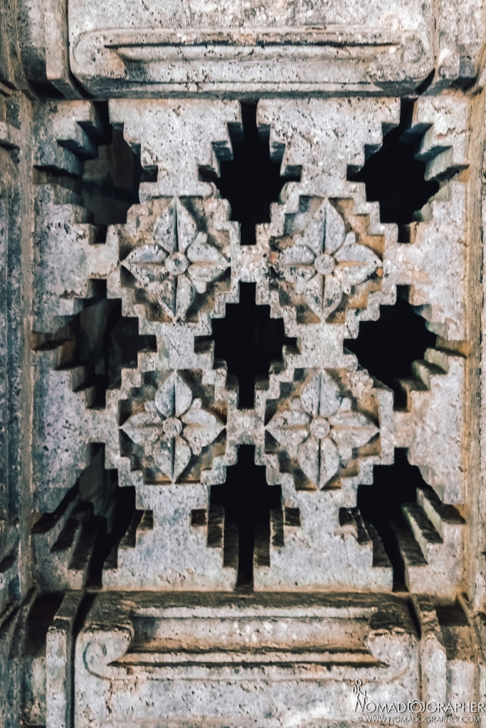 ONE OF THE PERFORATED DOOR SCREENS NEXT TO THE MAIN ENTRANCE OF THE 'GARBHAGRIHA'.